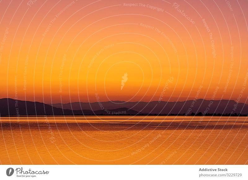Sunset with reflections in the water catalonia spain ebro delta mediterranean idyllic sunset water reflection sundown paradise sunbeam travel romantic bright