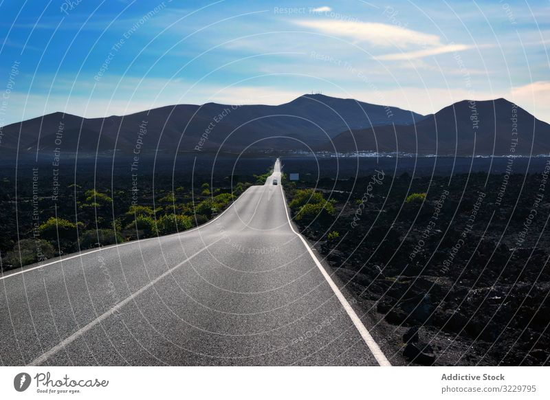 Endless road riding to mountains along fields nature landscape travel sky green summer perspective endless countryside way trip valley rural scenery adventure