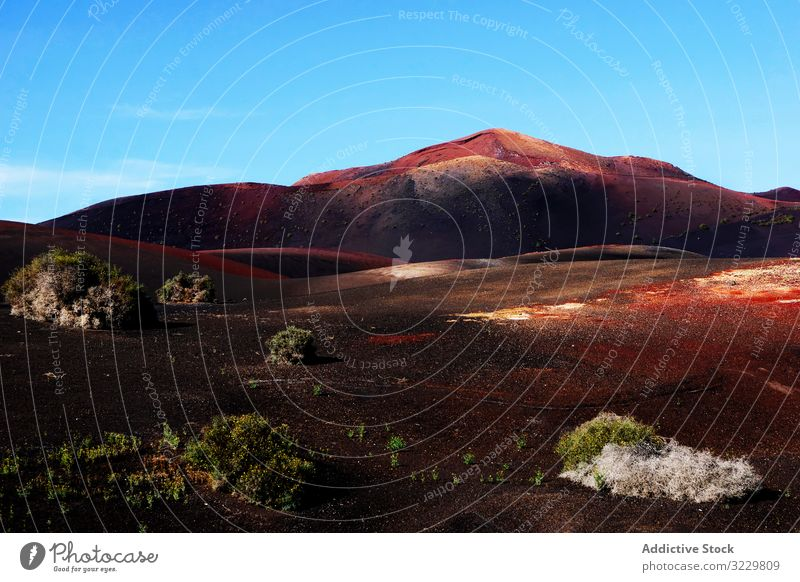 Picturesque view of volcanic terrain with solidified lava in wild area landscape deserted island burnt spain nature picturesque travel horizon scenic slope
