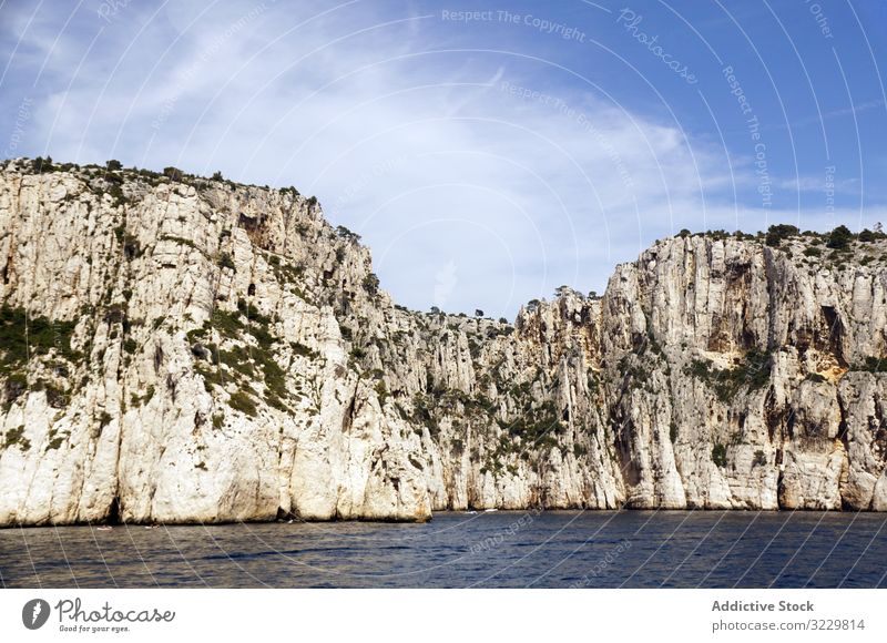 Beautiful white limestone rocks on seashore cliff landscape calanques massif france europe national park nature travel touristic attraction mountain water still