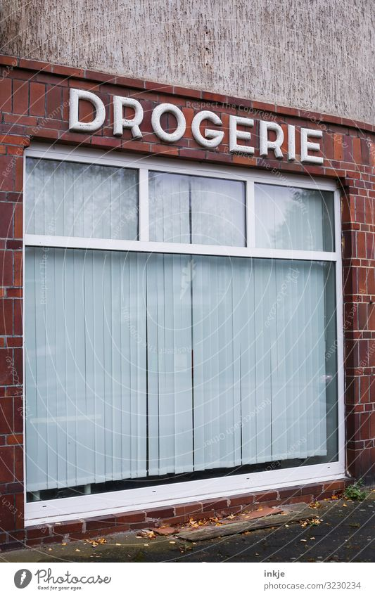 Behind closed curtains Trade Services Health care Drugstore Village Small Town Deserted Store premises Facade Window Shop window Old Authentic Gloomy Transience