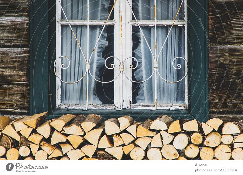 inside the warm room Upper Bavaria Village House (Residential Structure) Hut Wooden house Log home Farm Facade Window Shutter Curtain Firewood Stack of wood