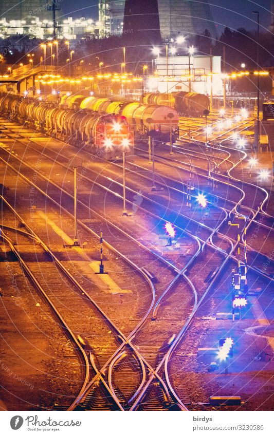Goods station nocturnal Industry Logistics Germany Train station Rail transport Railroad Freight train Railroad tracks Switch Railroad system Sea of light Light