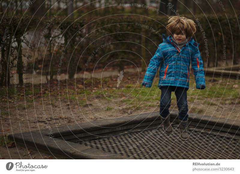 Boy jumps on a trampoline Forward Full-length Shallow depth of field blurriness Day Exterior shot Colour photo Dynamics Action Flying Trampoline Hop
