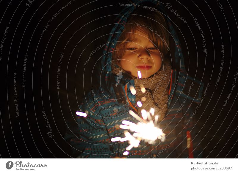 Child with sparkler Winter New Year New Year's Eve Sparkler Dark Light Fire Illuminate Night Evening Infancy Feasts & Celebrations Firecracker Burn Bright Hot
