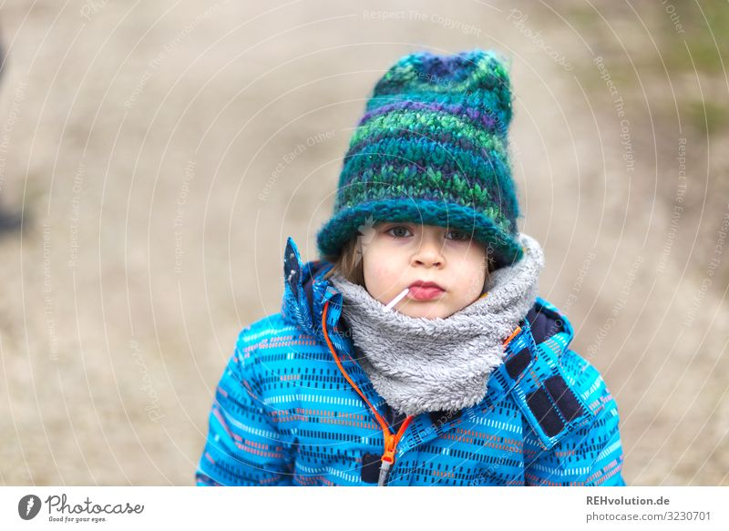 Boy with lollipop and cap Child Boy (child) Infancy 1 Human being 3 - 8 years Environment Nature Winter Lanes & trails Jacket Scarf Cap Authentic Simple Small