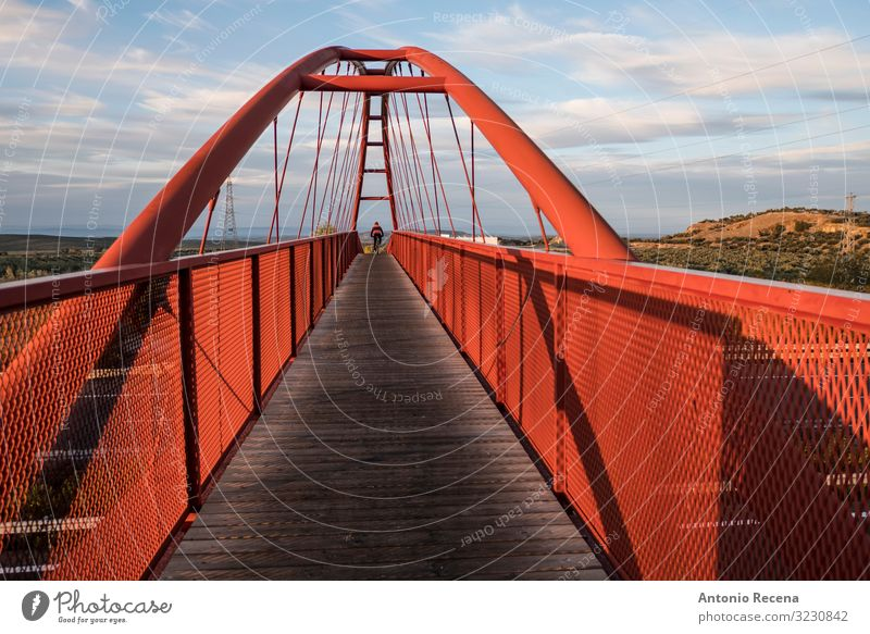 elevated red bridge over the highway with cyclist traveling Sports Cycling Landscape Sky Bridge Architecture Pedestrian Street Highway Overpass Wood Steel Red