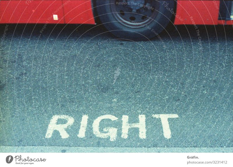 Right or Wrong sign typography Typography Street Pavement London bus stop Clue Warn Warning label Signage Signs and labeling Characters Exterior shot Bans