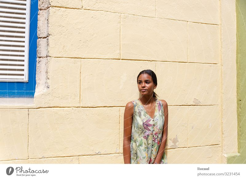 Young Cuban girl leaning on a wall in Havana, Cuba Woman Human being Youth (Young adults) Young woman Blue Beautiful Green Hand Flower Black Face Street Eyes