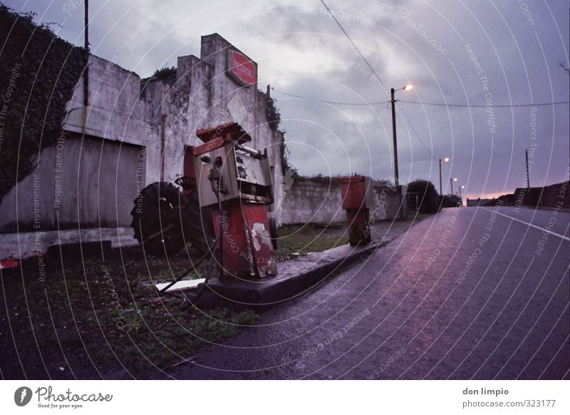 Filling station out of operation for years Petrol station Petrol pump Old Exterior shot Oil Transport Copy Space top Deserted Raw materials and fuels Gasoline