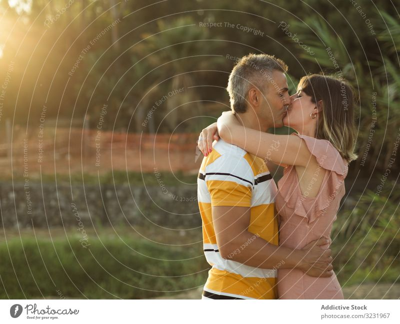 Happy couple looking at each other love smile happy vacation sunny daytime man woman adult honeymoon summer nature shore coast relationship holiday tropical