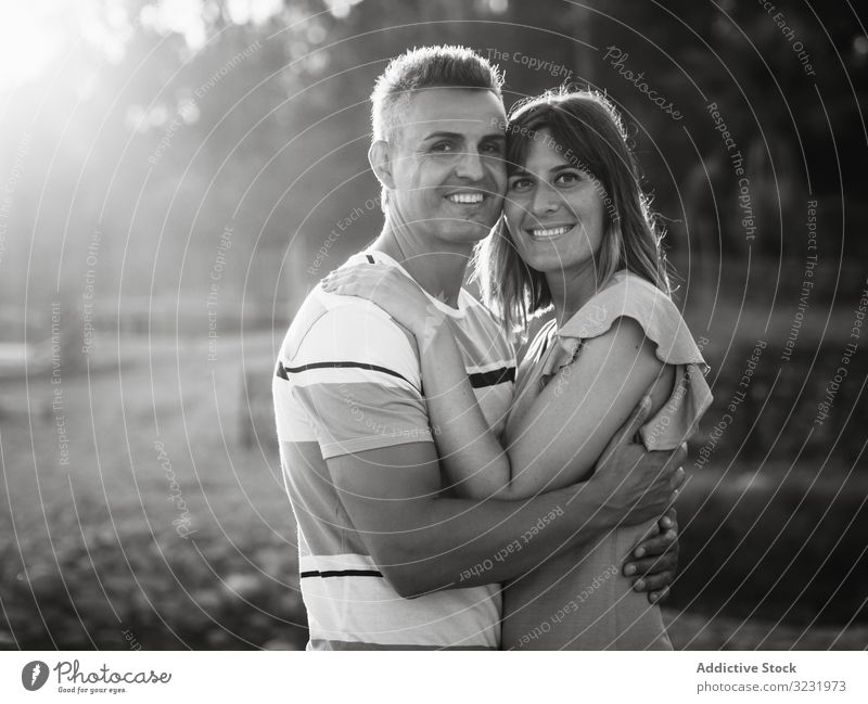Couple looking al camera with happy smile couple love vacation sunny daytime man woman adult honeymoon summer nature shore coast relationship holiday tropical