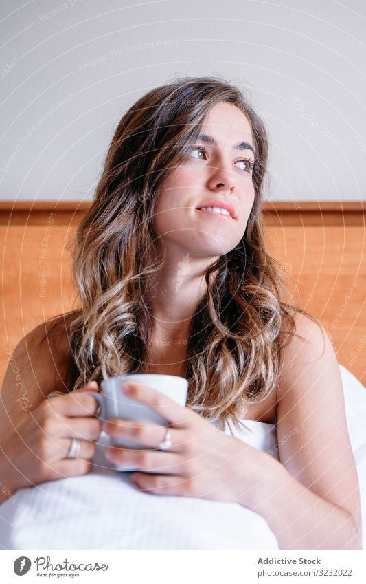 Girl in a bed with a cup of coffee pretty awake joy girl beauty indoors view home lying down sleep rest lifestyle beautiful waking young awakening morning