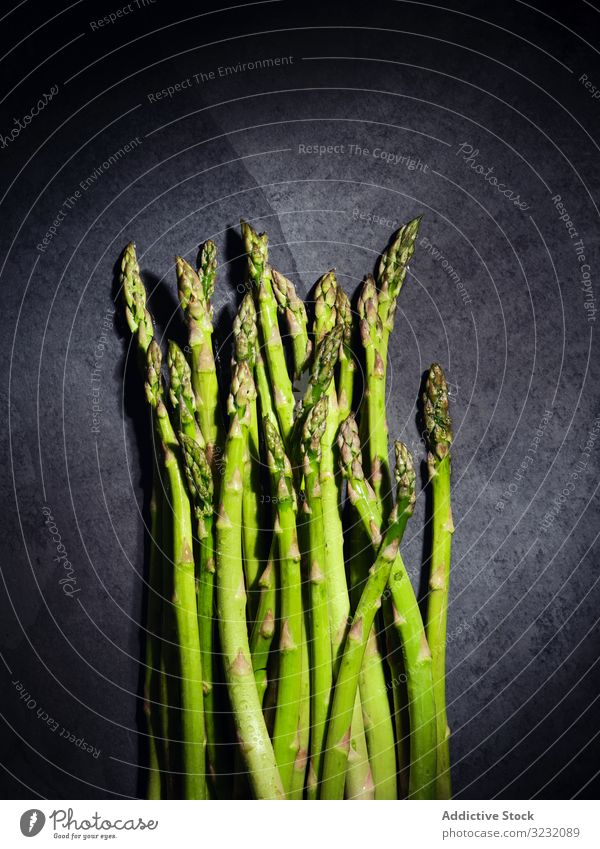 A bunch of green asparagus vegetable ingredient fresh diet food organic healthy vegetarian nutrition agriculture background white nature natural raw cuisine