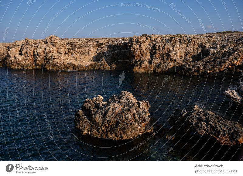 Picturesque rocky seashore on sunny day cliff ocean seascape formation scenery picturesque travel mountain ripple coastline tourism seaside landscape scenic sky