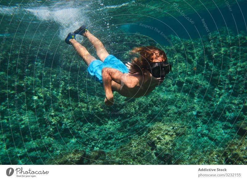 Male swimmer floating among sea waves boy underwater tranquil active surface training calm sport athlete person silent peace harmony energy guy leisure effort