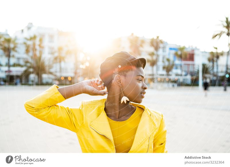 Portrait of a black woman stylish african american female jacket bright cute attractive positive healthy charming young pretty modern cheerful relax chill rest