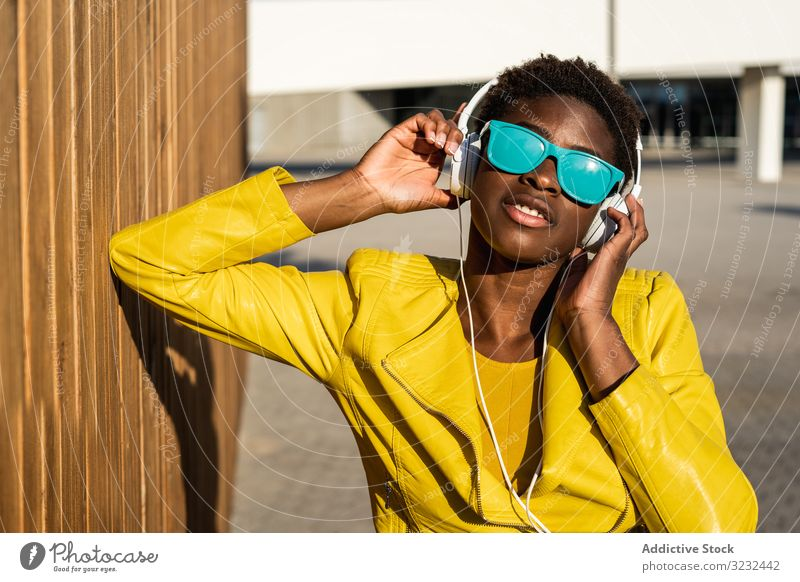 Portrait of a black woman stylish african american female jacket cute attractive positive healthy charming young pretty modern cheerful relax chill beauty