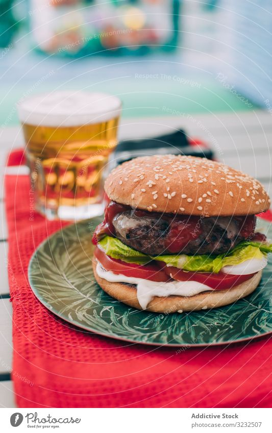 Cheeseburger with lettuce and tomato bun classic unhealthy table food meal cheeseburger onion beef delicious bbq grill snack hamburger american gourmet beer