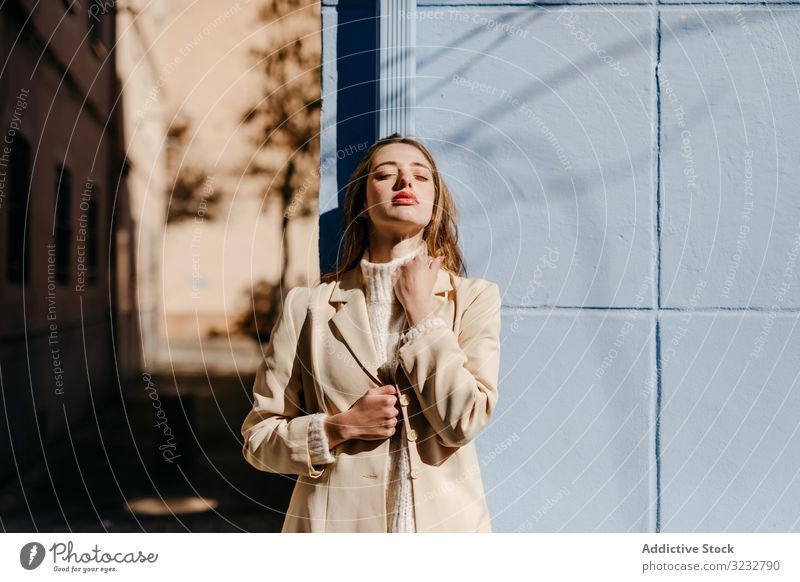 Sensual female standing blue building on the street woman stylish sunny protection young sensual urban fashion model cool trendy cover blouse elegant lady
