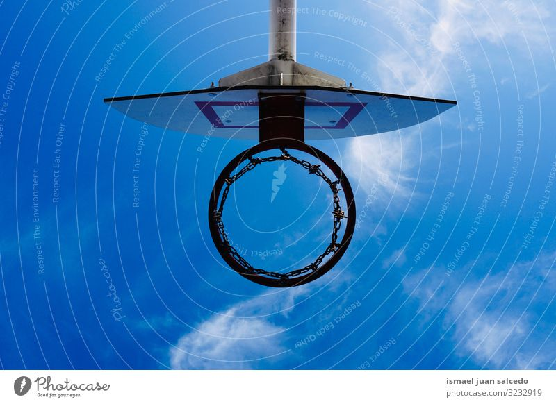 basketball hoop silhouette and blue sky, street basket in Bilbao city Spain circle chain metallic net sport sports equipment play playing playful old park