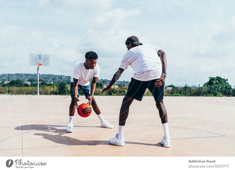 African American guys playing basketball in bright day sportsmen training player activity athlete skill action black african american court athletic