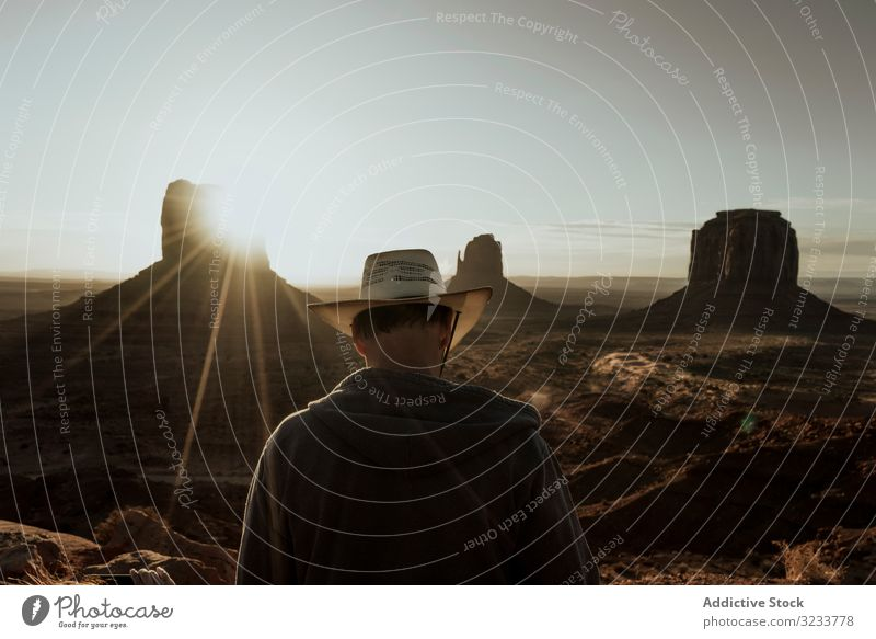 Man in hat looking at amazing structures in desert tourist travel nature landscape sunset old adventure ancient tourism sky beautiful ruins vacation natural