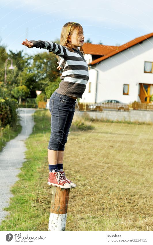 climber (done) Child Girl boyish Climbing Playing Reckless Pole Wooden stake Fence post Exterior shot Footpath House (Residential Structure) Village Building