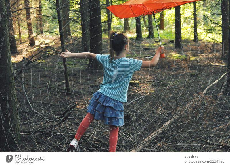 tree dancer Child Girl Infancy Childhood memory Forest Individual Leisure and hobbies Tree Tree trunk Woodground Balance Umbrella Skirt Undergrowth Light Shadow