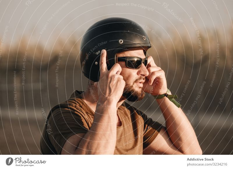 Pensive male in helmet man brutal beard sunglasses pensive biker travel ride motor style racer motorcyclist transport drive road motorcycle vehicle motorbike