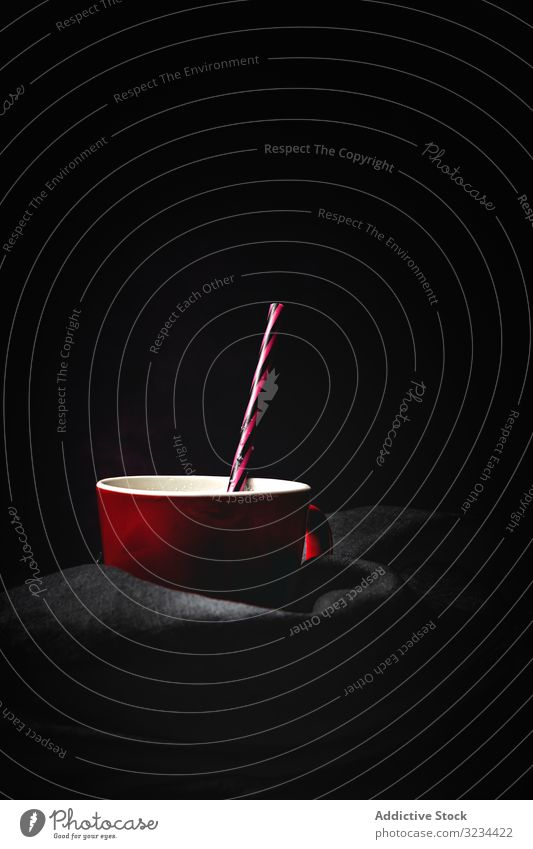 Cup of milk on table cup tall white bright straw striped contrast minimalist fresh cocktail milkshake drink beverage refreshment food nutrition ingredient diet