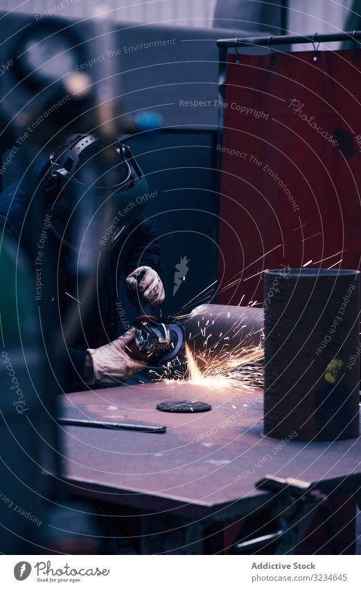 Professional welder in mask welding metal ironwork equipment man working manufacturing protective workplace job flame repair metalwork tool industry steel hot