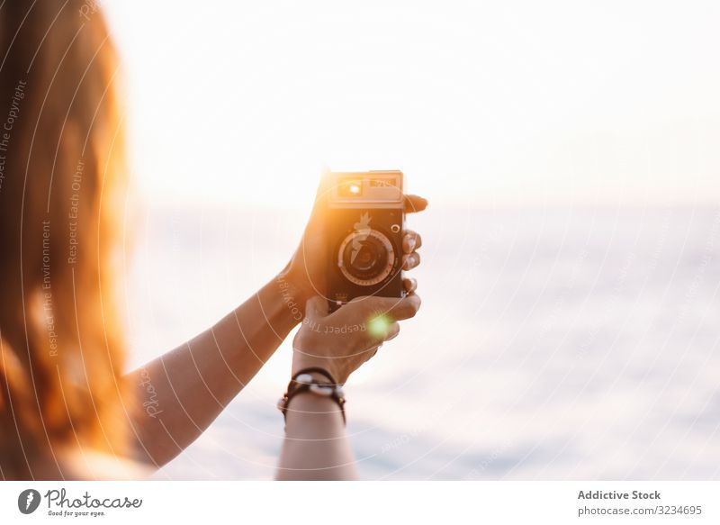 Creative woman taking photo on camera in sunny day creative architecture geometric picture female tourist young city tourism vacation holiday capture moment