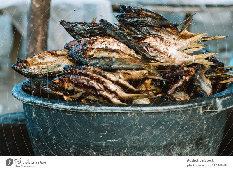 Bowl with heap of dried fish market bowl food seafood traditional cuisine smell many pile weathered grungy marketplace vendor sell trade dish meal prepared