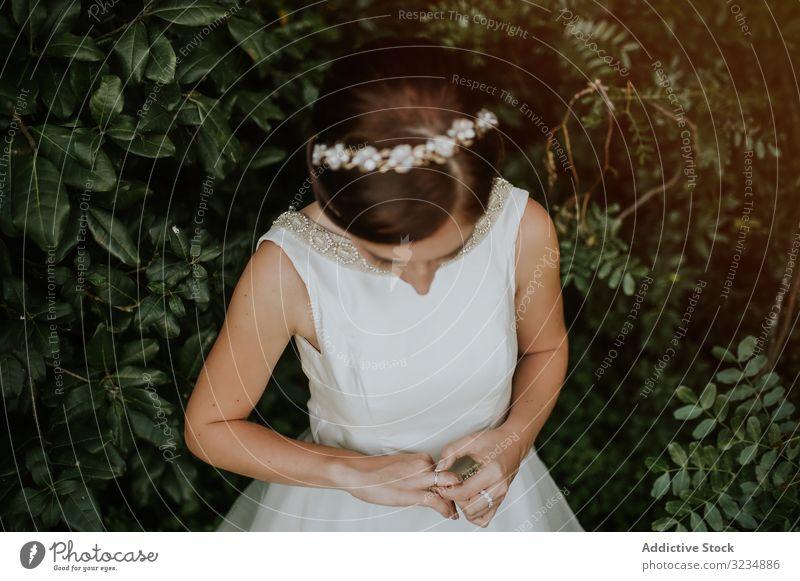 Bride in charming dress admiring finger ring in garden diamond wedding jewelry bride female bridal beautiful white diadem wife ceremony elegant marriage