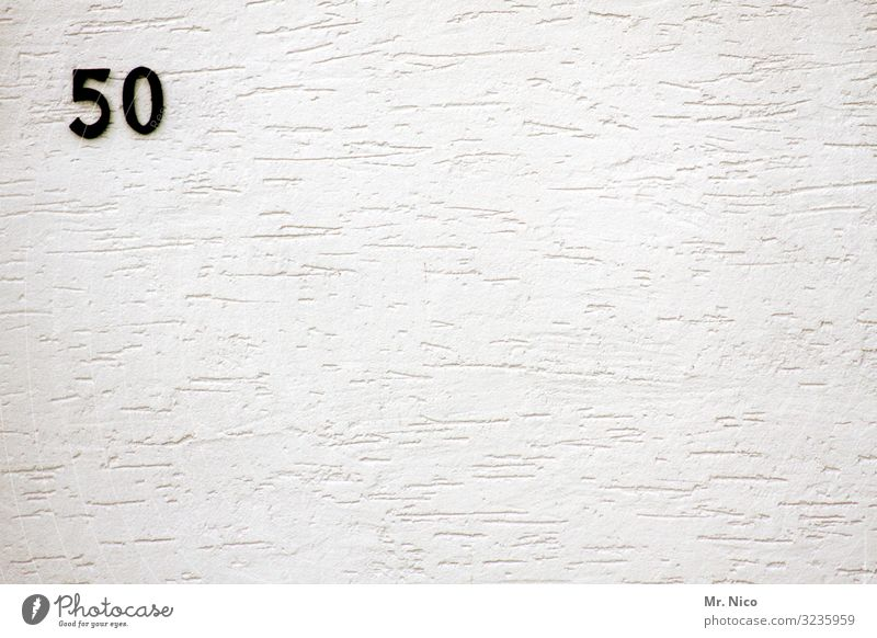 White Black Wall (building) Wall (barrier) Facade Birthday Signs and labeling Digits and numbers 0 5 Jubilee 50 The fifties Rendered facade House number