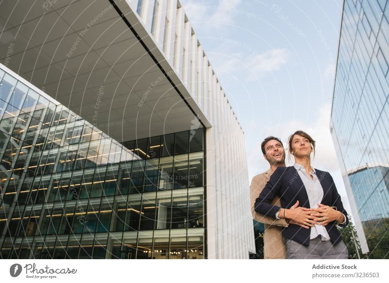Businesspeople couple outside contemporary building businesspeople street walk work smile man woman colleague together coworker office city town urban modern