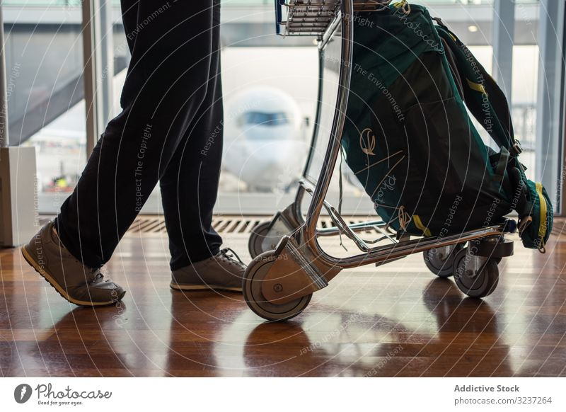 Person legs walking trolley woman luggage airport travel departure trip tourist holiday flight suitcase vacation journey passenger traveler tourism person
