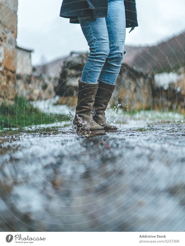 Man walking on wet autumn trail man boots footprint forest travel activity hike adventure nature male healthy exploration recreation footpath trekking legs