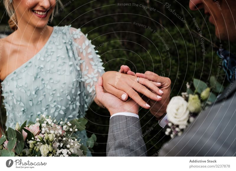 Cheerful newly wedded couple exchanging rings wedding love engagement happiness jewelry wife woman happy ceremony romance together husband marriage celebration