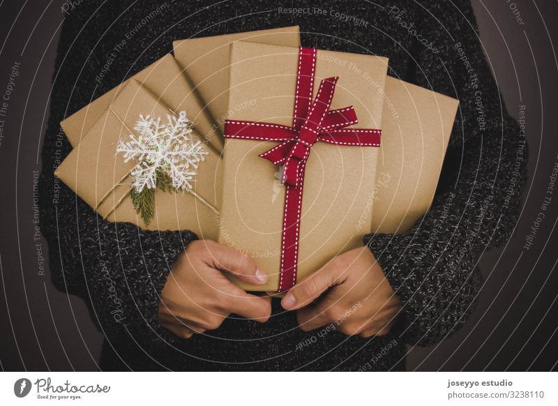 Woman with dark sweater holding many Christmas presents. Black Book Box Christmas & Advent claus composition Craft (trade) Dark Festive fir Friday Full Gift