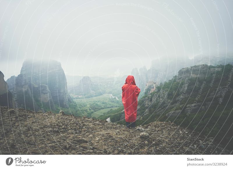 Woman with red raincoat on landscape of Meteora rocks, Greece Beautiful Vacation & Travel Tourism Summer Mountain Hiking Adults Culture Nature Landscape Sky Fog