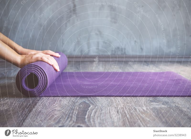 Woman rolling her mat after a yoga class Lifestyle Beautiful Body Relaxation Meditation Sports Yoga Human being Adults Fitness Thin young Practice pose workout