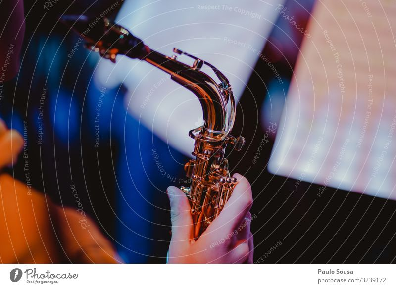 Close up hand holding a saxophone Saxophone Music Saxophon player Musician Human being Youth (Young adults) Brass Elegant Blues Sound Classical Professional