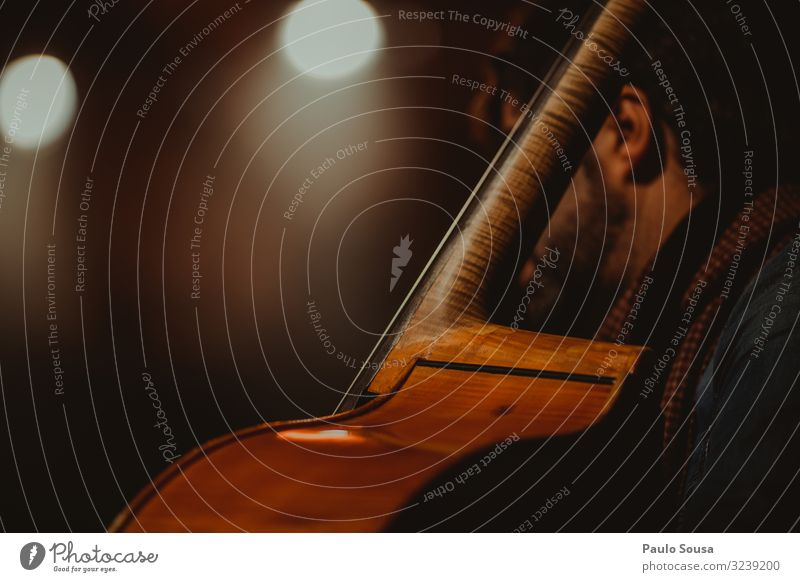 Man playing cello Cello Music Stage Orchestra Concert Colour photo Musician Listen to music Detail Interior shot Art Artificial light Copy Space Close-up Shadow
