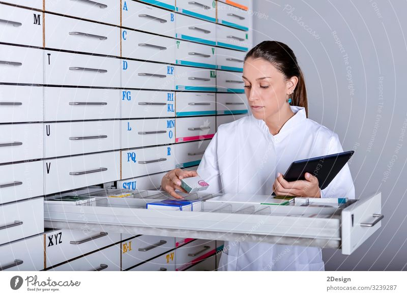 harmacist standing next to medicine shelves, holding tablet Happy Beautiful Illness Medication Apprentice Laboratory Work and employment Profession Technology
