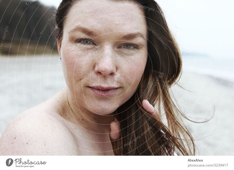 Portrait of a young woman on the beach Style Joy Beautiful Life Well-being Beach Ocean Young woman Youth (Young adults) Adults Skin Face Freckles 30 - 45 years
