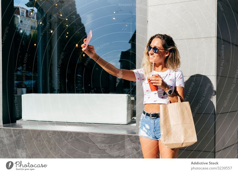 Cheerful woman leaving restaurant cafe drink healthy smile smartphone paper bag leave female urban vitamin beverage juice smoothie cup detox cheerful delighted