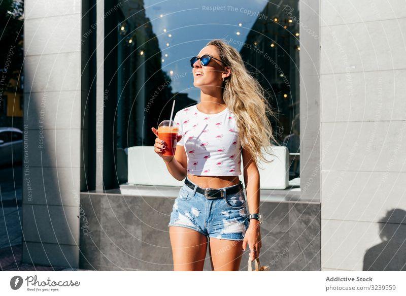 Stylish woman enjoying healthy drink on street smile city summer lifestyle urban female stylish trendy rest relax juice smoothie detox vitamin fruit lady