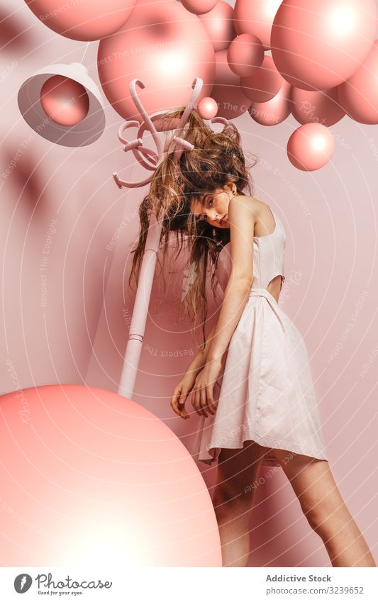 Teenage girl with tangled hair in a pink room clothes rack indoor annoyed girl frustrated female angry woman single difficulties nervous damaged desperate